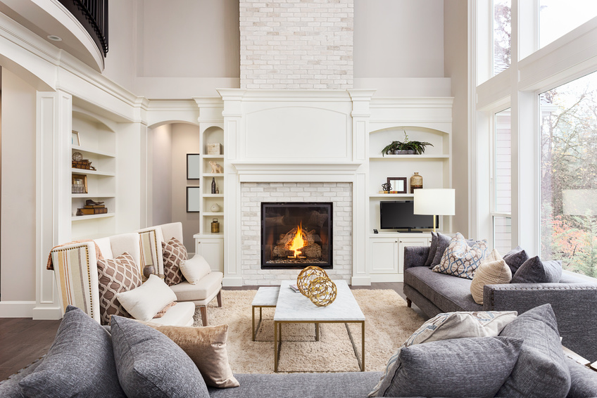 family room with burning logs in the fireplace
