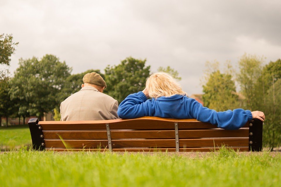 old couple on park bench