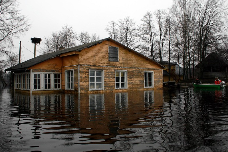 flooded house with rescue boat